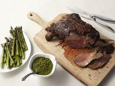Grilled Marinated Leg of Lamb with Asparagus and Mint Chimichurri from FoodNetwork.com
