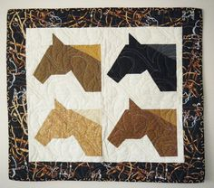 4 Horses - Quilted wall hanging 30 x 34. via Etsy.
