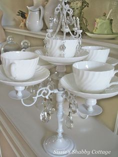 Even a simple tea set can become eye-catching decor, if you know how to repurpose it. This incredible shabby chic teacup candelabra is a creative and way to turn your retired teacup collection into new tabletop decor. Get the tutorial.     - CountryLiving.com