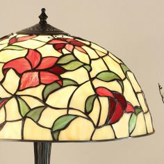 Red Lillies Cascades of vibrant red petals in stunning art glass.