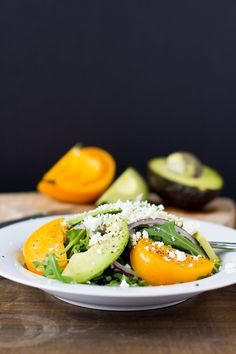 Arugula Salad with Avocado, Heirloom Tomato, Feta & Red Onion #cleaneating | www.thefoxandshe.com