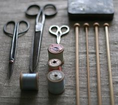 scissors, thread, knitting needles