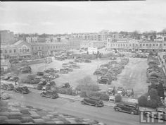The Plaza, 1938. This view is looking northwest from the building that now houses Tiffany (just west of Halls Plaza). The parking lot is now Starbucks, MAC, Topsy's, Classic Cup, several other stores and a parking garage. (MAC would be bottom left of the photo; Starbucks in the bottom right) #KC #KansasCity