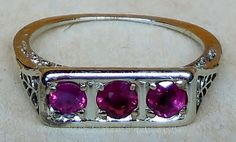 Vintage Antique .60ct Ruby 18K White Gold Art Deco Engagement / Cocktail Ring Featuring 3 Gorgeous Antique Rubies!! These rubies glow cherry