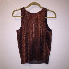 Orange Metallic Tank Top Orange metallic tank top from H&M. Has mesh underlay so it doesn't feel scratchy. Worn once. H&M Tops Blouses