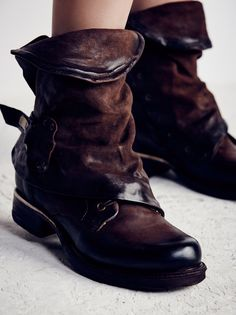Emerson Ankle Boot | This re-invented work boot by A.S.98. combines distressed leather, hammered hardware, and a hidden lace-up . Side zipper and buckle.
