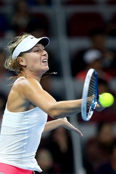 Maria Sharapova Photos: 2014 China Open - Day 8. Maria Sharapova of Russia returns a shot during her semi-final match against Ana Ivanovic of Serbia during day eight of the China Open at the China National Tennis Center on October 4, 2014 in Beijing, China.