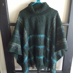 Anthropolgie poncho Anthropolgie poncho in evergreen with blue, white and purple plaid. Turtle neck. Wool. Anthropologie Sweaters Shrugs & Ponchos