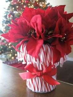For our Christmas party last year, I bought several Christmasy flower arrangements, carefully arranged them in vases, and placed them around the house. Classy, perhaps, but completely unimaginative. I'm pretty sure no one even noticed them. Not exactly money well spent. So this year I decided to get a little more creative (and thrifty) with …