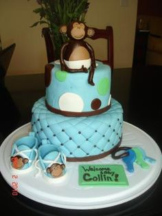 Mod Monkey Baby Shower Cake: I am in LOVE with this adorable cake sent in by Andrea. It is beautiful! The marshmallow fondant gives the whole cake a softer look (and it is quite tasty