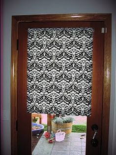 DIY roller shades - glue fabric to vinyl shade Wonder if you could do this decoupage style with paper?