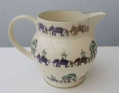 This is a huge Emma Bridgewater jug decorated all the way around the jug with elephants, even some inside.