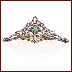 a petite diamond tiara with a central cabochon emerald