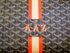 I NEED a Goyard Tote Bag ... loving the brown w/ orange monogram.