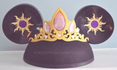 Idea to make your own Tangled ears! Can buy a pair of plain black ears (maybe have it personalized in the back with your name) and create removable customizations like this crown and starburts for Rapunzel (or do Jasmine's headband with some jasmine flowers in the ears, or Pocahontas' tattoo for a crown with feathers on the ears) that you can switch out. Multiple, custom ears with just one purchase :D
