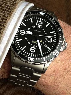 Finding myself more and more in love with this Sinn 857 UTC (tegimented steel) in original rather than PVD. Dream Watches, Sport Watches, Luxury Watches, Cool Watches, Rolex Watches, Watches For Men, Sinn Watch, Modern Watches, Wristwatches