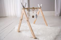 Clover and Birch Timber Gym Stone Grey Tips. Our simplistic baby gym is an alluring, purposeful addition to any nursery or childrens space. The modern design and neutral palette allows our baby gym to be a peaceful and stylish addition to your home without the overpowering presence of typical childrens gear. The aesthetic of the natural wood is soothing and invites play without being overstimulating. Our natural toy gyms and mobile accessory sets encourage your baby to develop their hand…