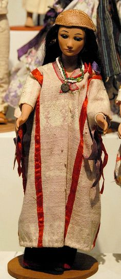 Mixtec Doll Oaxaca wearing a huipil of Santiago Ixtayutla, a Mixtec town in the foothills of the Sierra Madre mountains above Jamiltepec. On her head she wears an engraved half-gourd of the kind made in Pinotepa de Don Luis