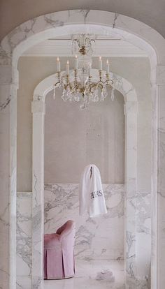Arches + chandelier + marble + pretty pink tufted chair = heaven