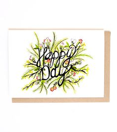 """Our Happy Day card features a hand-painted illustration. It includes the phrase """"Happy day"""". Printed in USA."""