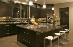 I love the huge island, the beautiful countertops and the large windows behind the sink!