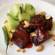 "The key to this dish is the rich Vietnamese-inspired dark caramel. ""A little bitterness in the caramel makes it more complex,"" Andrea Reusing says. ""I..."