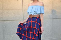 Transition your off the shoulder dress to fall by making it a top under a plaid midi