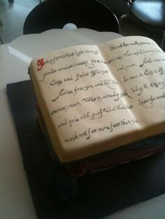 Shakespeare stacked book cakes, with an excerpt from Romeo and Juliet in writing based on Shakespeare's own handwriting
