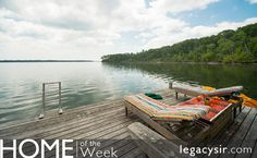 A private setting for this stunning custom waterfront home w/ dock & lovely hardscaping. Beautiful water views from most rooms, a very convenient location just 8 minutes to major highway access. 4BRs + a 5th room for flexible use; perfect for office.