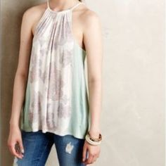 "Anthropologie Sz L Sorin Halter Tank Deletta New! Brand: Deletta from Anthropologie Type: Sorin Halter Tank Size: L  Rayon and silk blend Condition: New with tags! Originally $78!  Color: White, pink, light green-blue (tag says ""Mint"" Bust - 20.25"" across the front, lying flat.Length - 26.5"" from shoulder to hem.  NO - Trades Anthropologie Tops Blouses"