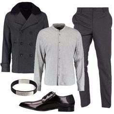 L'outfit è composto da un giaccone doppio petto in fantasia melange, una camicia slim con colletto alla coreana ed un paio di pantaloni eleganti. Il look si completa con un paio di stringate in pelle Versace Collection ed un particolare bracciale in acciaio Inox Emporio Armani.