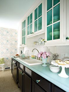 Colorful kitchen with two colors of cabinentry.