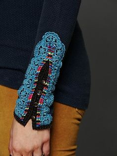 lace and colorful binding and buttons to highlight a long sleeved t-shirt  :  could do one or the other, a well....