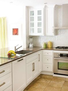 mosaic glass pearl-effect backsplash tile via Better Homes and Gardens, designer/photographer info unavailable.