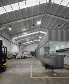 Image 19 of 27 from gallery of Renewal and new additions to industrial building / Photograph by Fernando Guerra Industrial Sheds, Industrial Office, Metal Building Homes, Building A House, Shed Office, Factory Architecture, Warehouse Design, Warehouse Office Space, Industrial Architecture