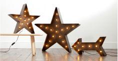 Star lighting, looks like a theatre prop. Broadway Star Floor Lamp in black | made.com