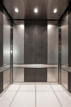 LEVELe-101 Elevator Interior with customized panel layout; panels in Stainless Steel with Sandstone finish, Bonded Nickel Silver with Dark Patina and Charleston pattern; Round Handrail at the Waterfront Pearl, Portland, Oregon