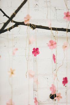 DIY cherry blossom wedding details - photo by Jenn Byrne Creative http://ruffledblog.com/diy-paper-cherry-blossom-backdrop