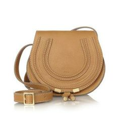 Light brown leather bag with roomy shape