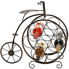 Display your favorite bottles of wine in this wrought-iron wine rack. This whimsical piece, which features a tricycle-shaped design, holds up to seven bottles of wine. You wine collection will definitely stand out in this unique and functional display. Wine Rack Storage, Wine Racks, Kitchen Storage, Wine Refrigerator, Wine Collection, Wine Bottle Holders, Wine Gifts, Wrought Iron, Cool Kitchens