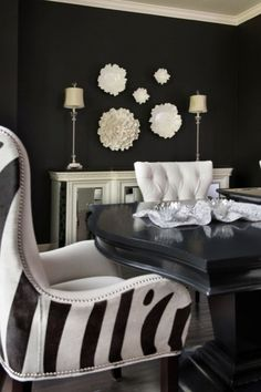 Beautiful black dining room with white and black accents. | Design & photo by ramseyinteriors.com
