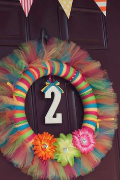 Tulle tied wreath... Lily's 2nd Birthday Party | CatchMyParty.com
