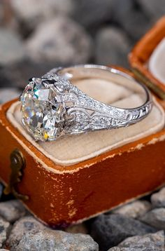 The Edwardian style ring is centered with one old mine cut diamond weighing carats and set into an eight-prong head. The ring features a pierced design and is accented with fifty-six bead set, old European cut diamonds, bordered with milgrain edging. Diamond Wedding Rings, Diamond Rings, Diamond Engagement Rings, Diamond Cuts, Solitaire Engagement, Halo Diamond, Diamond Jewelry, Wedding Bands, Antique Engagement Rings