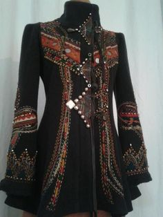 I don't know where this jacket came from but oh my God is it gorgeous! Love the orange and red tribal details and the sleeves have a gorgeous renaissance feel to them!