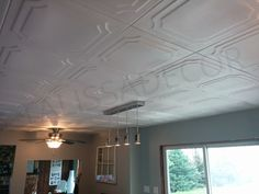 About our Styrofoam Ceiling Tiles Polystyrene (Styrofoam) ceiling tiles are one of the fastest and easiest ways to cover the popcorn ceilings and enhance any rooms decor. All you need to do is glue the ceiling tiles directly over the popcorn. The tiles have beveled edges for an easy butt joint 3d Wall Panels, Ceiling Panels, Ceiling Lights, Ceiling Ideas, Plank Ceiling, White Ceiling, Ceiling Decor, Ceiling Design, Styrofoam Ceiling Tiles
