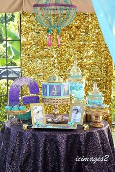 Gold and purple dessert table at a Princess Jasmine birthday party! See more party planning ideas at CatchMyParty.com!
