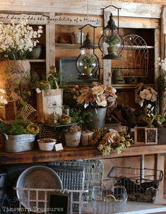 Garden display featuring lifelike herbs, lanterns, bird nests, burlap, and more