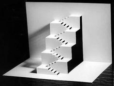 This kirigami, Stairs, is created by using a single sheet of paper. First the design is created on the paper then carefully cut out to transform it into three dimensional form.