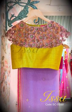 :Lavender saree with yellow shoulder patterened blouse.We can customize . Saree Blouse Neck Designs, Choli Designs, Saree Blouse Patterns, Fancy Blouse Designs, Designer Blouse Patterns, Stylish Blouse Design, Blouse Models, Blouse Styles, Clothes For Women