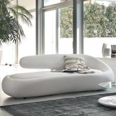 Duny sofa by Tonin Casa is a striking modern seating element that offers both decorative and functional qualities. Duny sofa offers extreme Italian quality, structure sturdiness and a tailoring technique which enhances its sculptural shape.